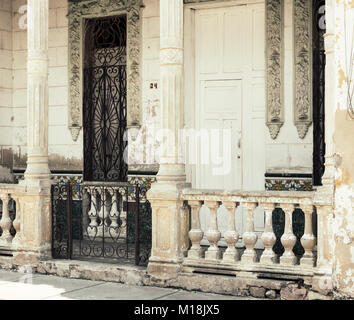 Holguin, Cuba - August 31, 2017: Weathered beautiful front entrance of a house. - Stock Photo
