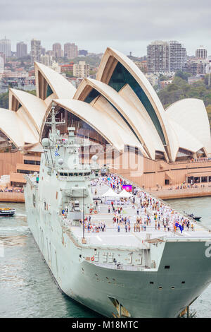 HMAS Canberra L02 Landing Helicopter Dock in front of Sydney Opera House during annual Australia Day celebrations - Stock Photo