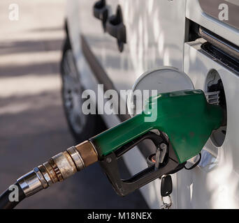 Filling up  with fuel in the car, fuel pistol isolated.Stock Photo. - Stock Photo