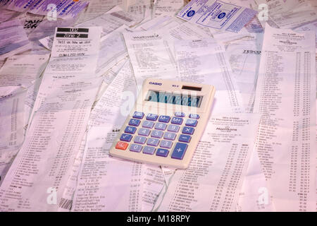 A pile of itemised shopping receipts / bills for multiple purchases - mainly at supermarkets - in British sterling - Stock Photo