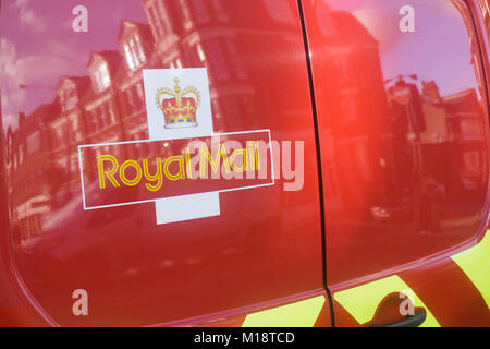 LONDON, UK - January 26th 2018: Roal mail logo on a red van. Royal mail is the postal service in great britain - Stock Photo