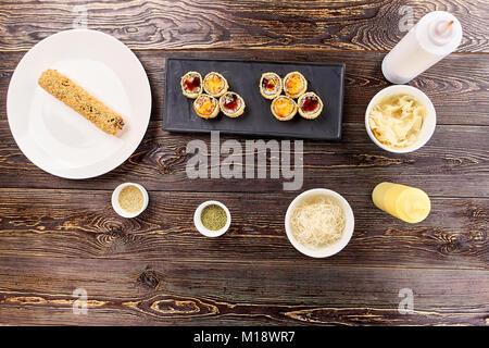 Cut and uncut rolls unagi furay and side dish. - Stock Photo