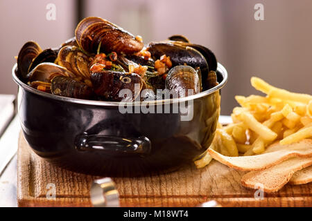 Closeup mussels in saucepan. - Stock Photo