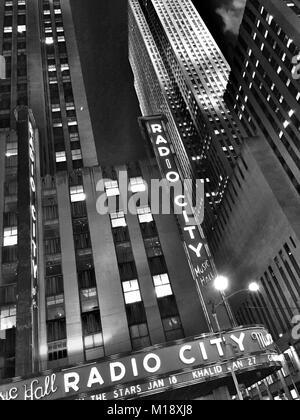 Radio City Music Hall in Rockefeller Center at Night, NYC, USA - Stock Photo