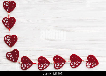 Valentines Day frame of wooden hearts and paper roses against a ...