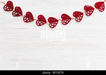 valentine's day concept. stylish red hearts border on white rustic wooden background flat lay. space for text. happy - Stock Photo