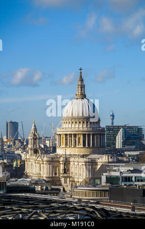 Rooftop view of the iconic dome of St Paul's Cathedral by Sir Christopher Wren on London's skyline, City of London, - Stock Photo