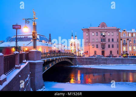 SAINT - PETERSBURG, RUSSIA - JANUARY 23, 2018: The Panteleymonovsky bridge over Fontanka River. On the background - Stock Photo