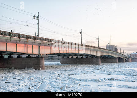 SAINT - PETERSBURG, RUSSIA - JANUARY 23, 2018: People on The Liteyny Bridge over The Neva River in winter cold and - Stock Photo