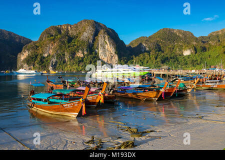 Phi Phi Island Krabi Thailand January 30, 2016 Traditional longtail boats moored at the beach of Ao Tonsai, on Koh - Stock Photo