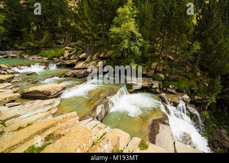 Steps of limestone strata make a waterfall on the Rio Arazas in the scenic upper Ordesa Valley. Ordesa National - Stock Photo