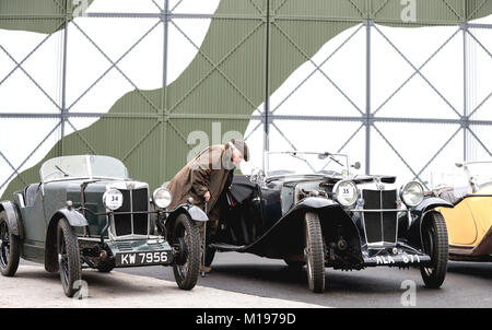A man looks at a line up of pre-war MG cars during the annual driving tests for the Vintage Sports-Car Club, around - Stock Photo