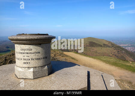 The toposcope and memorial on Worcestershire Beacon in hazy spring sunshine, the highest point on the Malvern Hills - Stock Photo