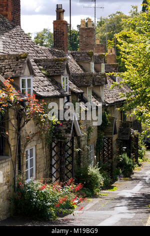 A row of picturesque Cotswold cottages in Winchcombe, Gloucestershire, UK. - Stock Photo