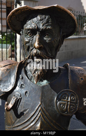 sculpture in bronze with the bust of don Quixote of la Mancha - Stock Photo