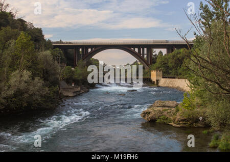 view of dam for hydroelectric power production and highway bridge on the Adda river - Stock Photo
