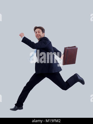 Isolated attractive business man running away from someone. - Stock Photo
