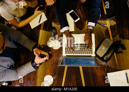 Business people meeting in office top view - Stock Photo