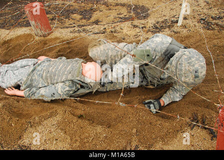 Spc. Benjamin Mason, Arizona Army National Guard, drags a casualty dummy during the obstacle course event in the - Stock Photo