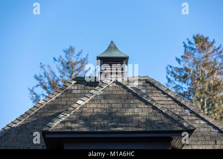 top of a small old house with weathered shingles - Stock Photo