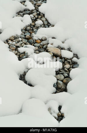 Pebbles and snow, Winter patterns, Banff National Park, Canadian Rockies, Alberta, CANADA - Stock Photo