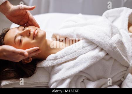 girl having spa facial massage in luxurious beauty salon - Stock Photo