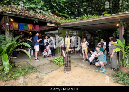 Tourists at the entrance of Mari Mari Cultural Village, Kota Kinabalu, Sabah, Borneo, Malaysia - Stock Photo