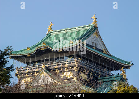 (27 January 2018 Osaka Japan) Osaka Castle Main tower  and its stone wall - Stock Photo