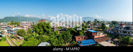Panoramic view of Pokhara in Nepal. The Machapuchare and the Annapurna range in the background. - Stock Photo