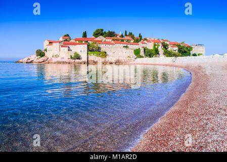 Sveti Stefan, Montenegro. Budva sightseeing with idyllic small island on the Adriatic Sea coast. - Stock Photo