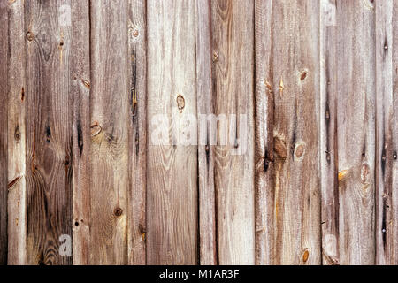 Weathered wooden fence texture with rusty nail heads - Stock Photo