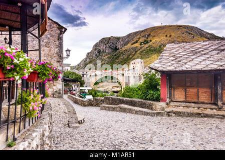 Mostar, Bosnia and Herzegovina. The Old Bridge, Stari Most, with emerald river Neretva. - Stock Photo