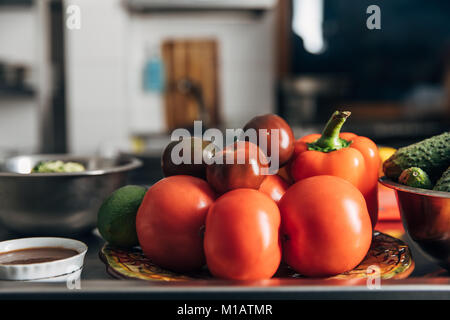 various fresh vegetables on table at restaurant kitchen - Stock Photo