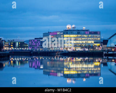 Evening view of BBC Scotland headquarters reflected in River Clyde in Glasgow , Scotland, United Kingdom - Stock Photo