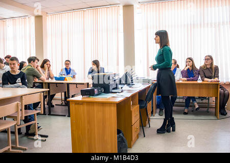 Students in the classroom with teacher - Stock Photo