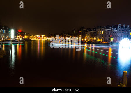 Festival of light 2017, Amsterdam, Netherlands - The Amstel Canal is illuminated with different pieces during the - Stock Photo