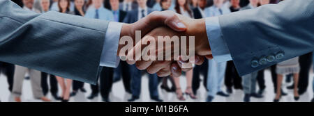 Closeup of a business handshake - Stock Photo