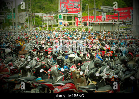 Motorcycles parking near a shopping mall in Phuket, Thailand. - Stock Photo