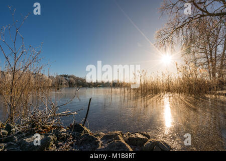 Sunshine over the frozen Schloonsee in Bansin. - Stock Photo