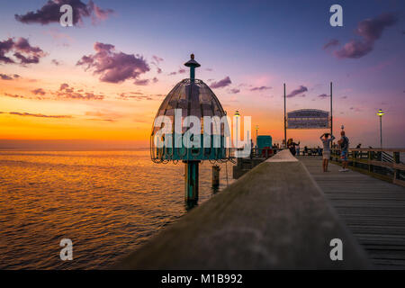 The pier with diving bell in Zinnowitz in summer shortly after Sunset - Stock Photo