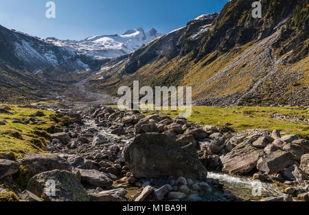 Stream in Wildgerlostal in National Park Hohe Tauern with great mountains and snow, Austria. - Stock Photo