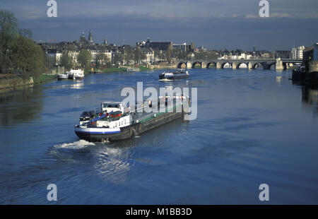 The Netherlands. Maastricht. Cargo ship on river called Maas. - Stock Photo