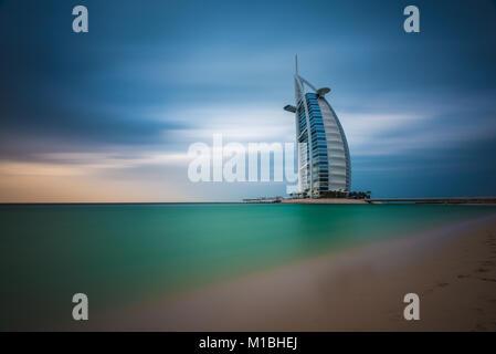 Views of the luxury beachfront hotel Burj Al Arab located on a man-made island in Dubai, UAE, United Arab Emirates - Stock Photo
