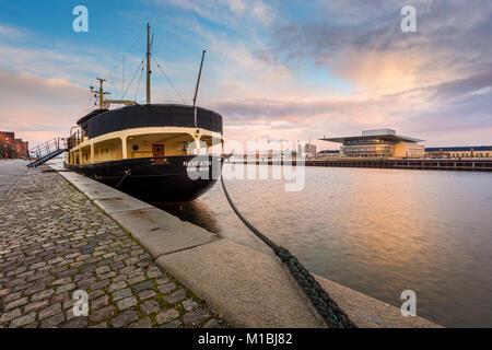 COPENHAGEN, DENMARAK- February 02, 2017: View of the Copenhagen Opera House and ship of the wharf. The national - Stock Photo