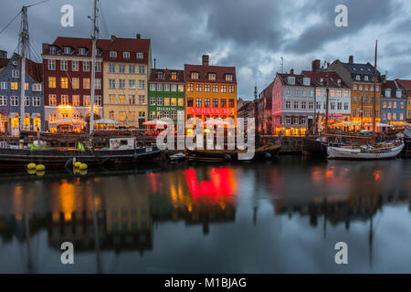 COPENHAGEN, DENMARK - FEBRUARY 28, 2017: Nyhavn at night. A 17th-century waterfront, canal and entertainment district - Stock Photo