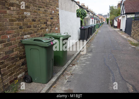 Domestic recycling bins and general household rubbish bins left out along street of residential area, UK - Stock Photo