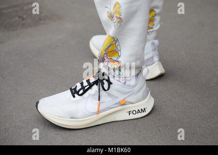MILAN - JANUARY 15: Man with white Nike foam shoes and trousers with butterflies design before Fendi fashion show, - Stock Photo