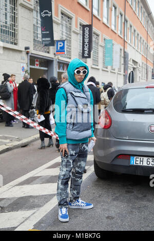 MILAN - JANUARY 15: Man with Stone Island gray jacket, turquoise blue hoodie and white sunglsses before Represent - Stock Photo