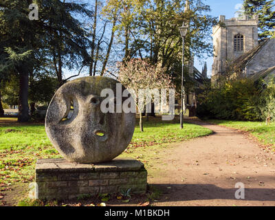 Modern 'Garden God' sculpture by Peter Inchbald outside St Andrew's Church in Abbey Park. Pershore, Worcestershire, - Stock Photo