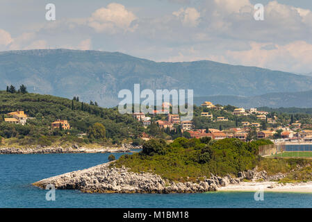 A view Kassiopi village with houses on the hills. North east coast of Corfu island, Greece - Stock Photo